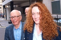 Rebekah Brooks and Rupert Murdoch are seen outside Mr Murdochs London flat.
