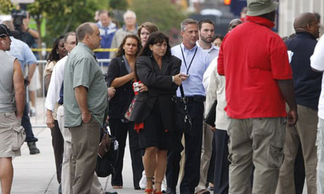 Staff are led to safety from the Washington naval yard. Photograph: Jonathan Ernst/Reuters