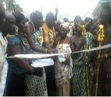 The traditional leaders cutting the tape to commission the project