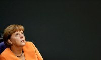 A euro for your thoughts: despite seven years in charge, Germany often wonders what Angela Merkel really believes. Photograph: Fabrizio Bensch/Reuters
