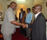 The Ashanti Regional Minister, Dr. Kwaku Agyeman Mensah (left) congratulating the committee members