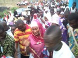A large crowd following Samira Bawumia to the Tafo Zongo chiefs's house
