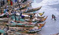 Catch of the day: fishermen with long boats on Ghana's Gold Coast. Photograph: Richard Dobson/Getty Images