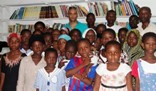 Jay Ghartey poses with pupils and teachers of his Nima Charity School