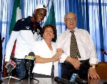 Day of reckoning: Balotelli with his proud foster parents as he gains Italian citizenship