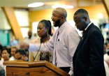 Accompanied by their attorney, Ben Crump, right, Trayvon Martin's parents, Sybrina Fulton and Tracy Martin, passionately addressed the Sanford, Fla., City Commission on Monday.