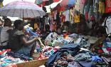 A third of all globally donated clothes end up in sub-Saharan Africa via wholesale rag houses, where they end up lining the streets or small boutiques such as this market at Katangua in Nigeria. Photograph: Monica Mark for the Guardian