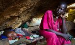 A mother and her child shelter from air strikes in a cave in South Kordofan in the Nuba mountains. Photograph: Adriane Ohanesian/AFP